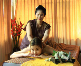 Thai massage with herb oil